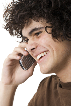 Teenager Boy Holding Cell Phone LANG_EVOIMAGES