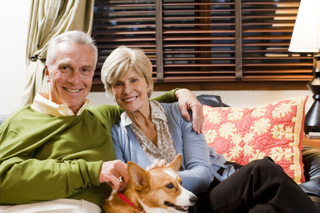 Mature Couple On Sofa With Dog LANG_EVOIMAGES