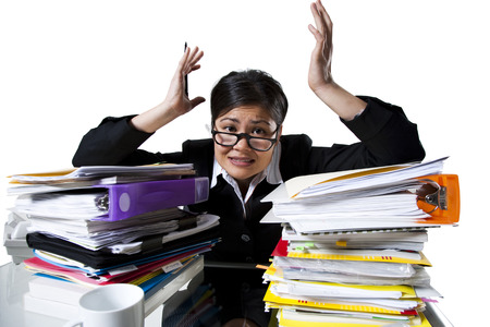 Woman With Stack Of Binders And Paperwork