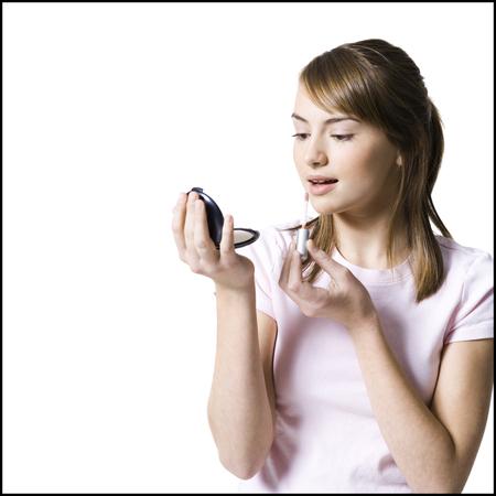 grooming product: Teenager Applying Make Up