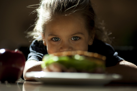 look latino: Young Girl Looking At Sandwich Sulking
