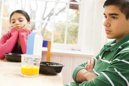 Girl Sulking At Breakfast Table LANG_EVOIMAGES