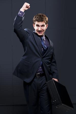 puños cerrados: Business Man With Briefcase And Arm Up Smiling