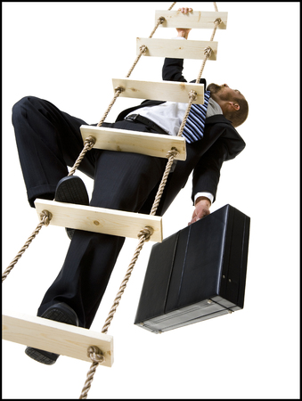 Businessman Climbing A Ladder With Briefcase LANG_EVOIMAGES