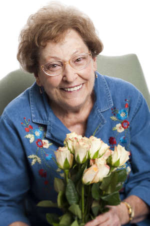 Elderly Woman Sitting In An Armchair Smiling