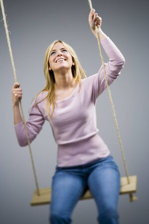 Woman On Swing Smiling