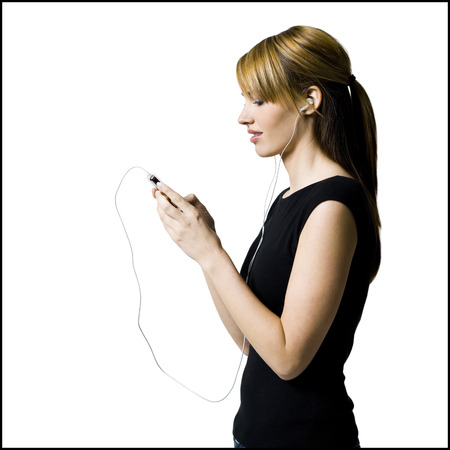 mp3 player: Woman With Listening Device And Earbuds