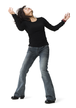 Full Length Woman Posing In Blue Jeans With Hands On Hips