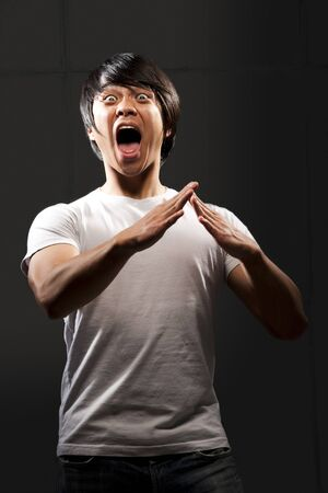 Muscular Man With Clenched Fist Shouting LANG_EVOIMAGES