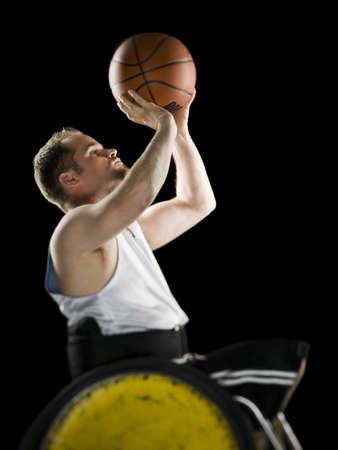 Wheelchair Athlete Holding Basketball