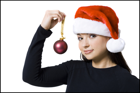Woman With Christmas Ornament And Santa Hat