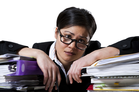 burned out: Woman With Stack Of Binders
