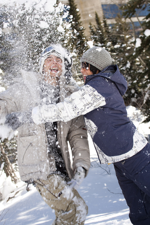 Young Adults Play Fighting In The Snow LANG_EVOIMAGES