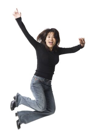 vietnamese ethnicity: Casually Dressed Woman Leaping LANG_EVOIMAGES