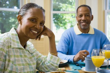 chequer: Portrait Of A Senior Man And A Senior Woman Sitting At The Breakfast Table LANG_EVOIMAGES