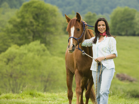 Portrait Of A Woman Standing With A Horse
