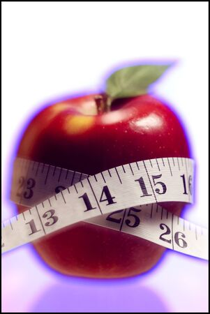 Close-Up Of A Tape Measure Around An Apple