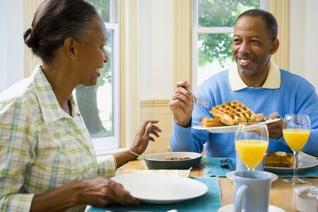 chequer: Senior Man And A Senior Woman Having Breakfast LANG_EVOIMAGES