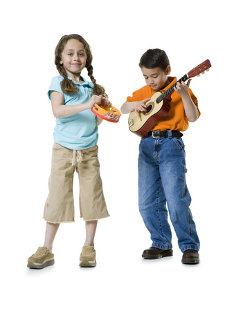 Portrait Of A Boy Playing The Guitar With A Girl Standing Beside Him
