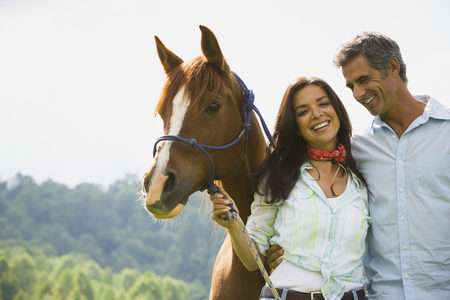Portrait Of A Man And A  Woman Standing With A Horse
