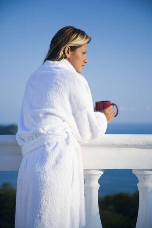 Woman In Housecoat Relaxing Outdoors