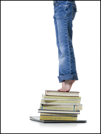 profile picture: Low Section View Of A Girl Standing On A Stack Of Books LANG_EVOIMAGES