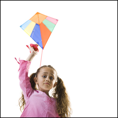 Young Girl Flying A Kite LANG_EVOIMAGES