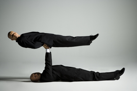 profile picture: Profile Of Two Male Acrobats In Business Suits Performing