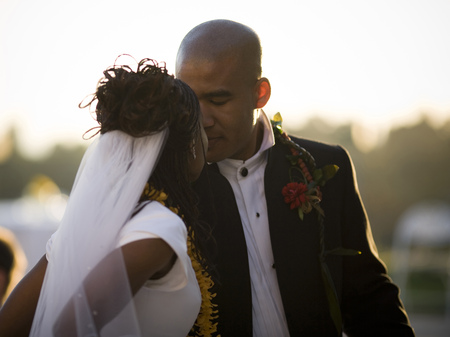 Close-Up Of A Bride And Groom Kissing LANG_EVOIMAGES