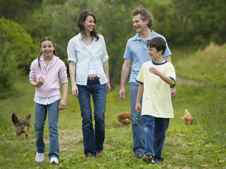 levis: Family Walking In A Field