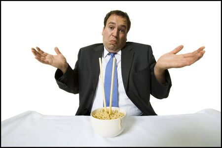 Businessmen Eating Noodles LANG_EVOIMAGES