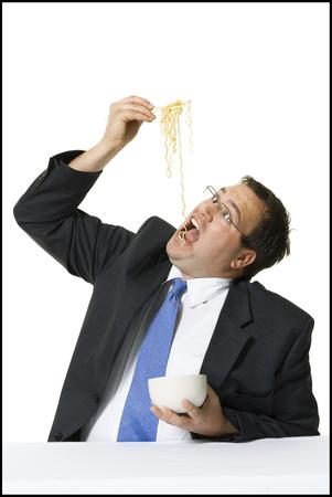 Businessman Awkwardly Eating Noodles