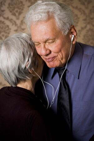 Profile Of An Elderly Couple Dancing And Listening To Music LANG_EVOIMAGES