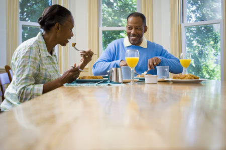 Senior Man And A Senior Woman Having Breakfast LANG_EVOIMAGES