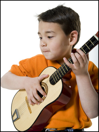 Portrait Of A Boy Playing The Guitar
