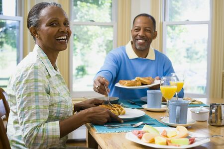 chequer: Close-Up Of A Senior Man And A Senior Woman Having Breakfast LANG_EVOIMAGES