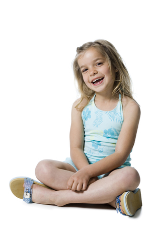 b: Young Girl Posing And Sitting Cross Legged LANG_EVOIMAGES