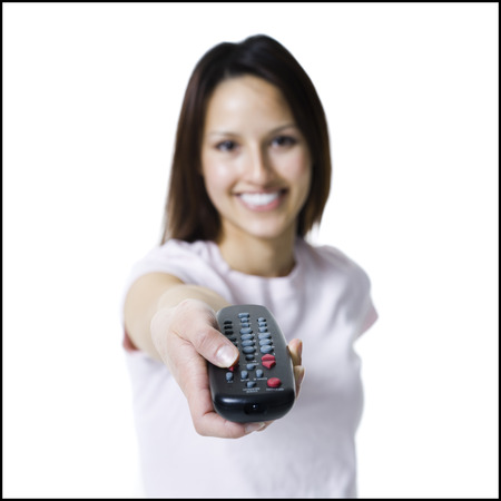 Woman Pointing And Pressing A Handheld Remote Control