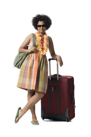 Portrait Of A Young Woman Standing With Luggage