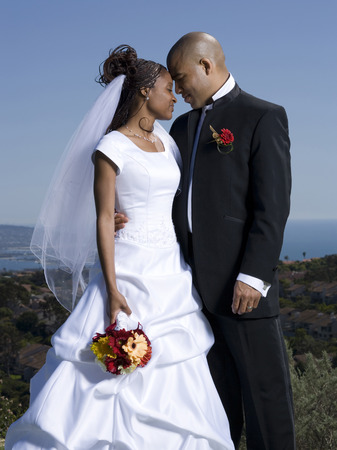 Newlywed Couple Standing Together With Their Eyes Closed