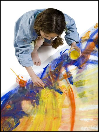 High Angle View Of A Girl Painting On The Floor