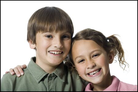 Portrait Of A Boy And His Sister Smiling LANG_EVOIMAGES