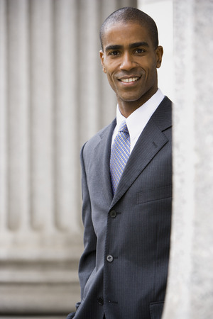 Portrait Of A Male Lawyer Standing In Front Of A Courthouse And Smiling