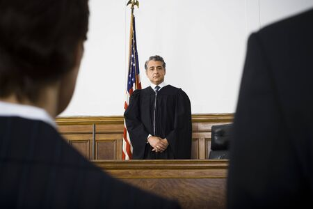 magistrates: Judge Standing In Front Of Defendants And Lawyers