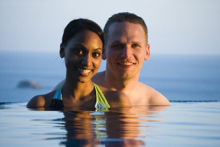 Portrait Of A Young Couple In A Swimming Pool