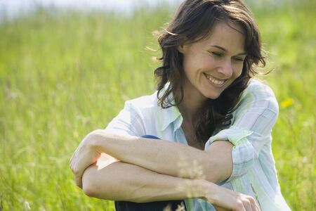 Close-Up Of A Woman Smiling With Her Arms Crossed LANG_EVOIMAGES