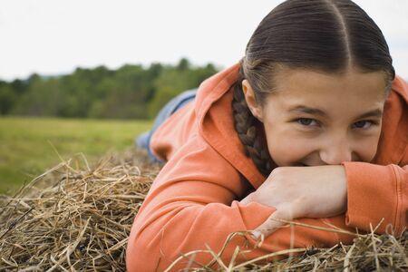 ebullient: Portrait Of A Girl Leaning Over A Haystack LANG_EVOIMAGES