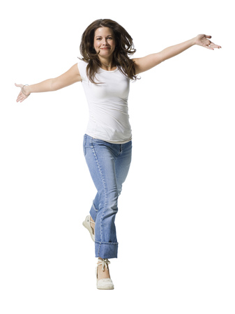 mode: Portrait Of A Mid Adult Woman Running With Her Arms Outstretched