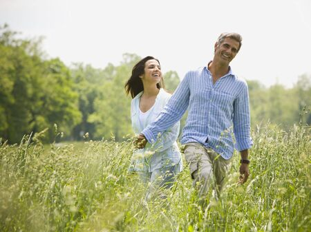 ebullient: Man And A Woman Holding Hands In A Field LANG_EVOIMAGES