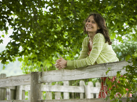 profile picture: Portrait Of A Woman Leaning On A Wooden Fence LANG_EVOIMAGES